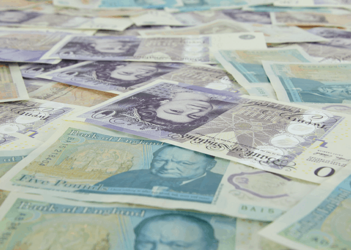 uk money on bed for expensive mattress